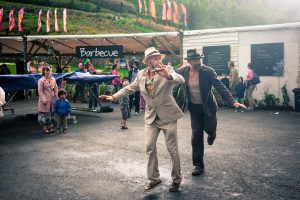 Dancing in the rain. Eden Project. St Austell, Cornwall