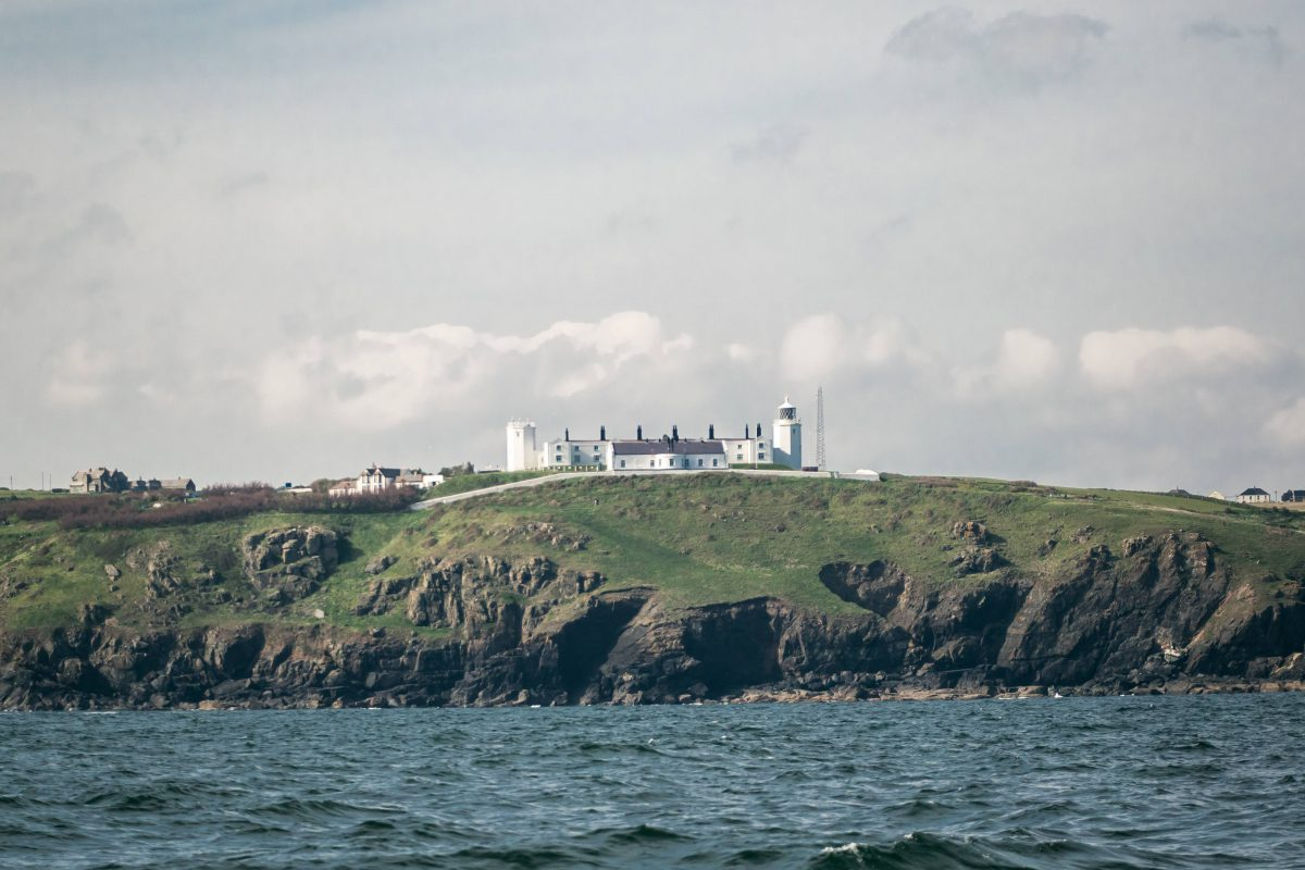 Photograph 'Lizard lighthouse from the sea, Lizard, Cornwall'